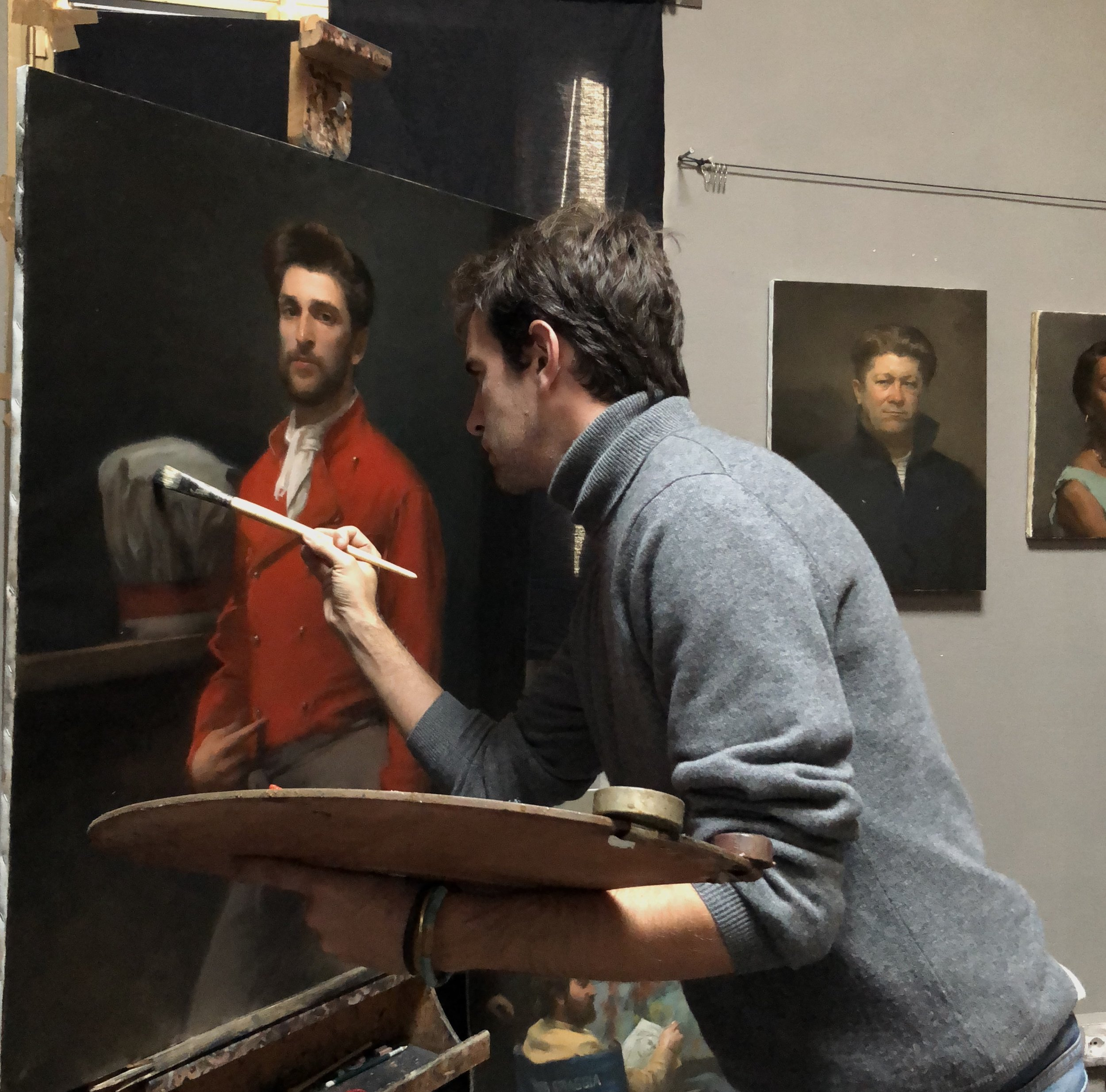 Tom Richards working on a portrait in his studio.