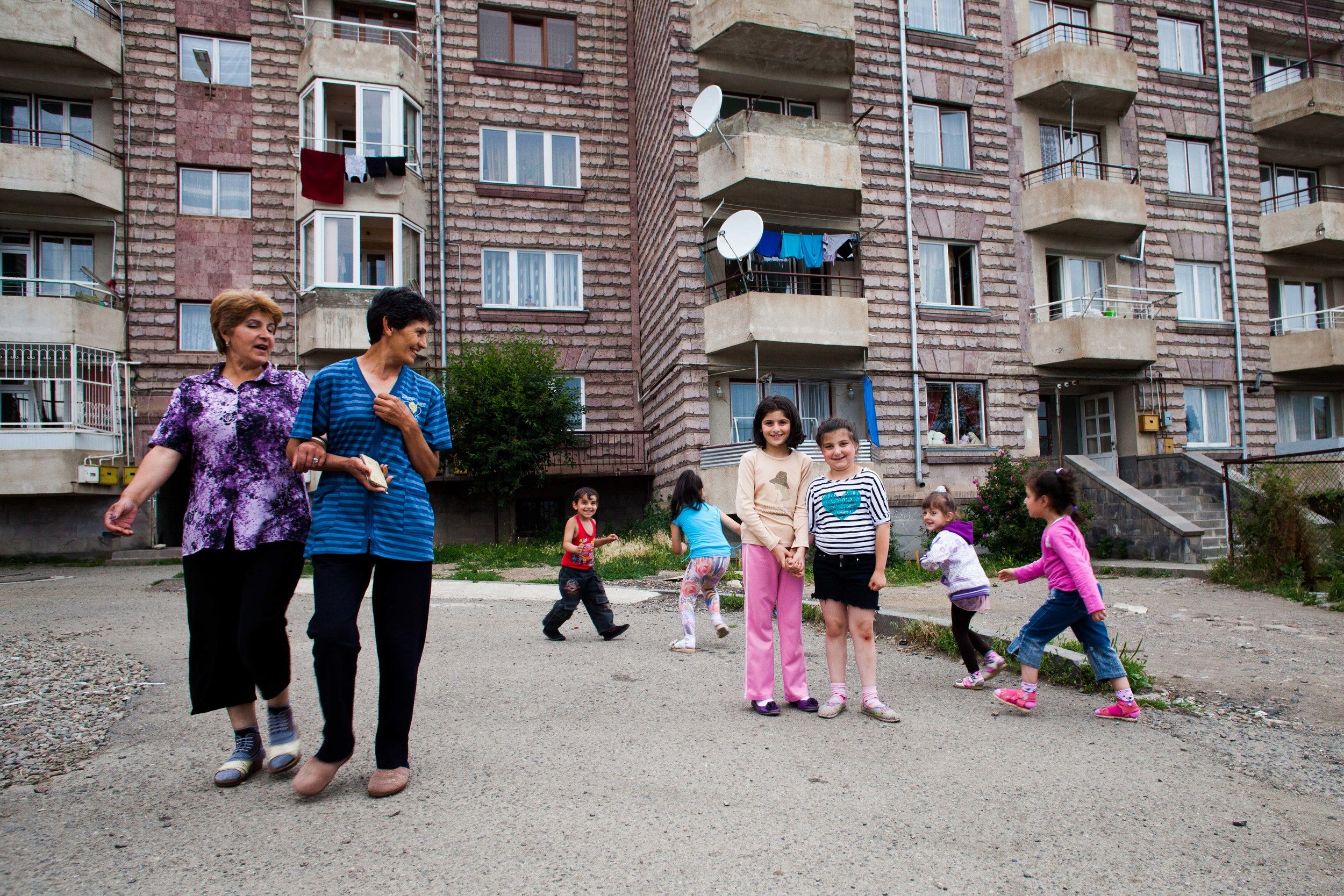 Local Spitak community members spend time outside on a summer day.