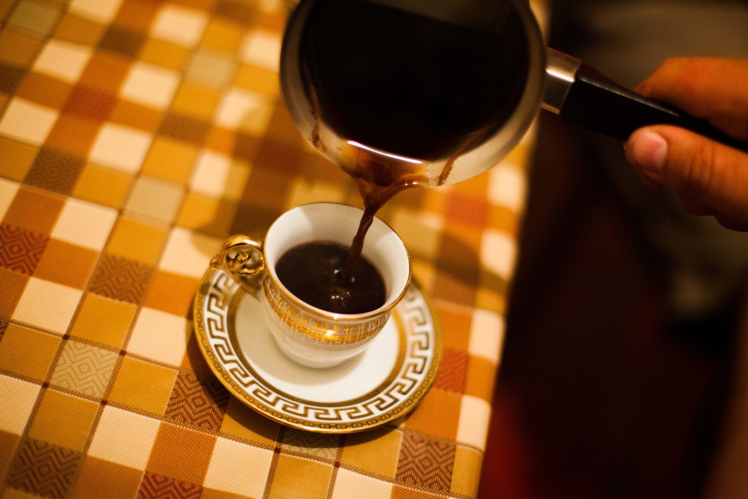 Small cups of strong black coffee are served multiple times throughout the day and are normally drank while socializing with friends.