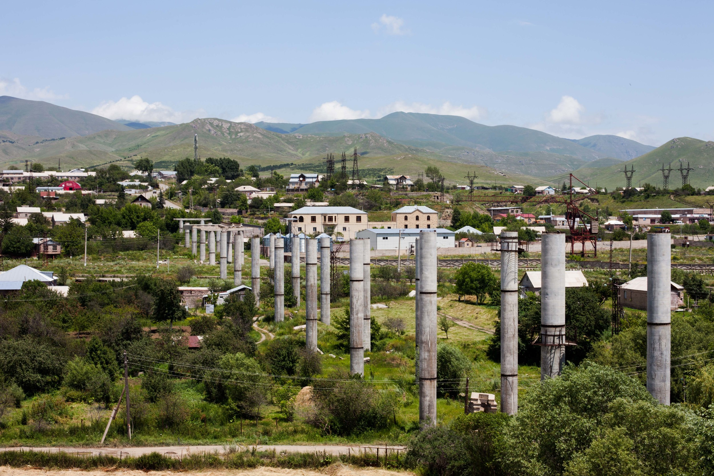 An unfinished bridge runs through the landscape of Spitak, a reminder of their time under Soviet rule.