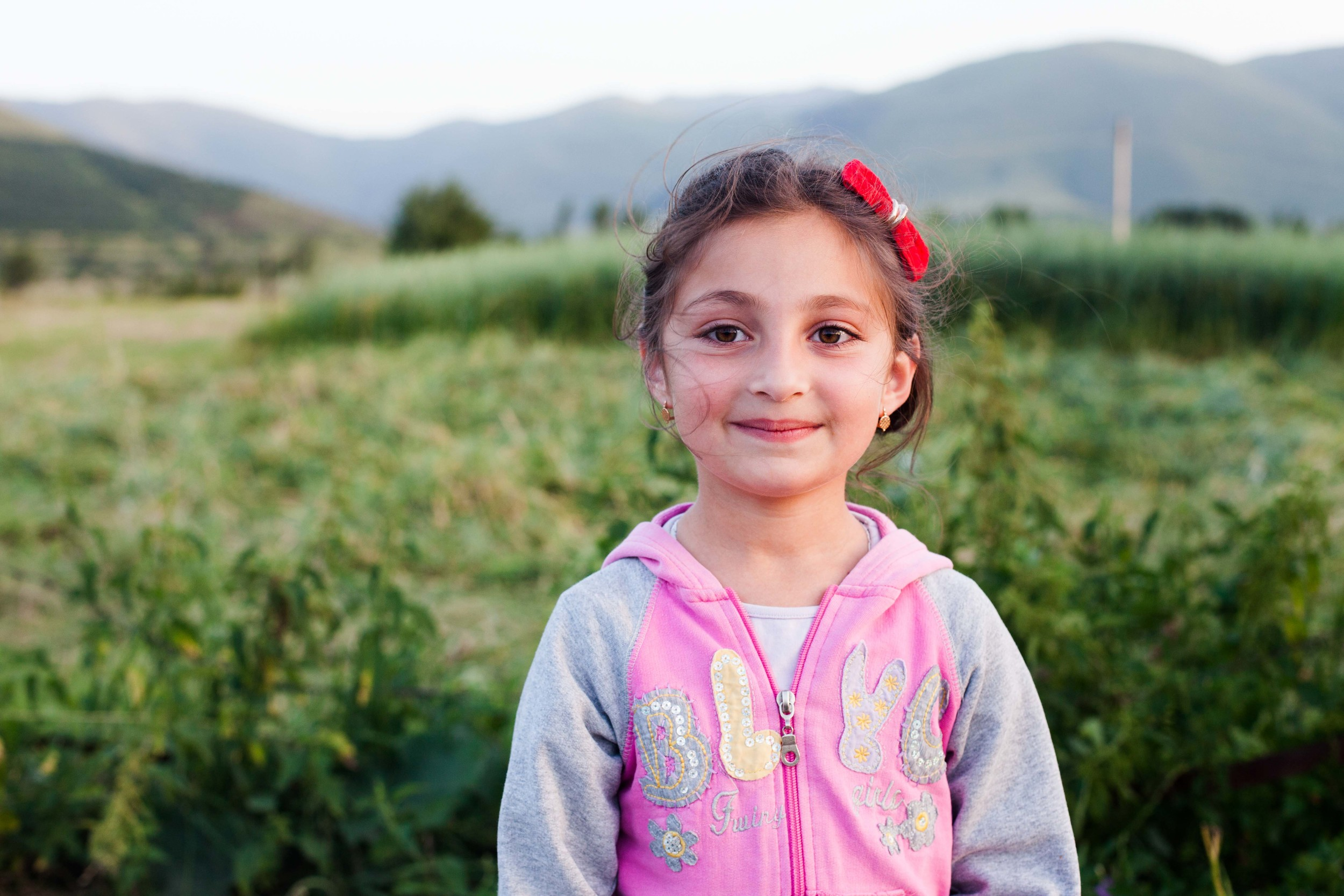 Karinka, a young Armenian, poses for a portrait nearby her home in Spitak. She is praised by her mother for her lady-like qualities.