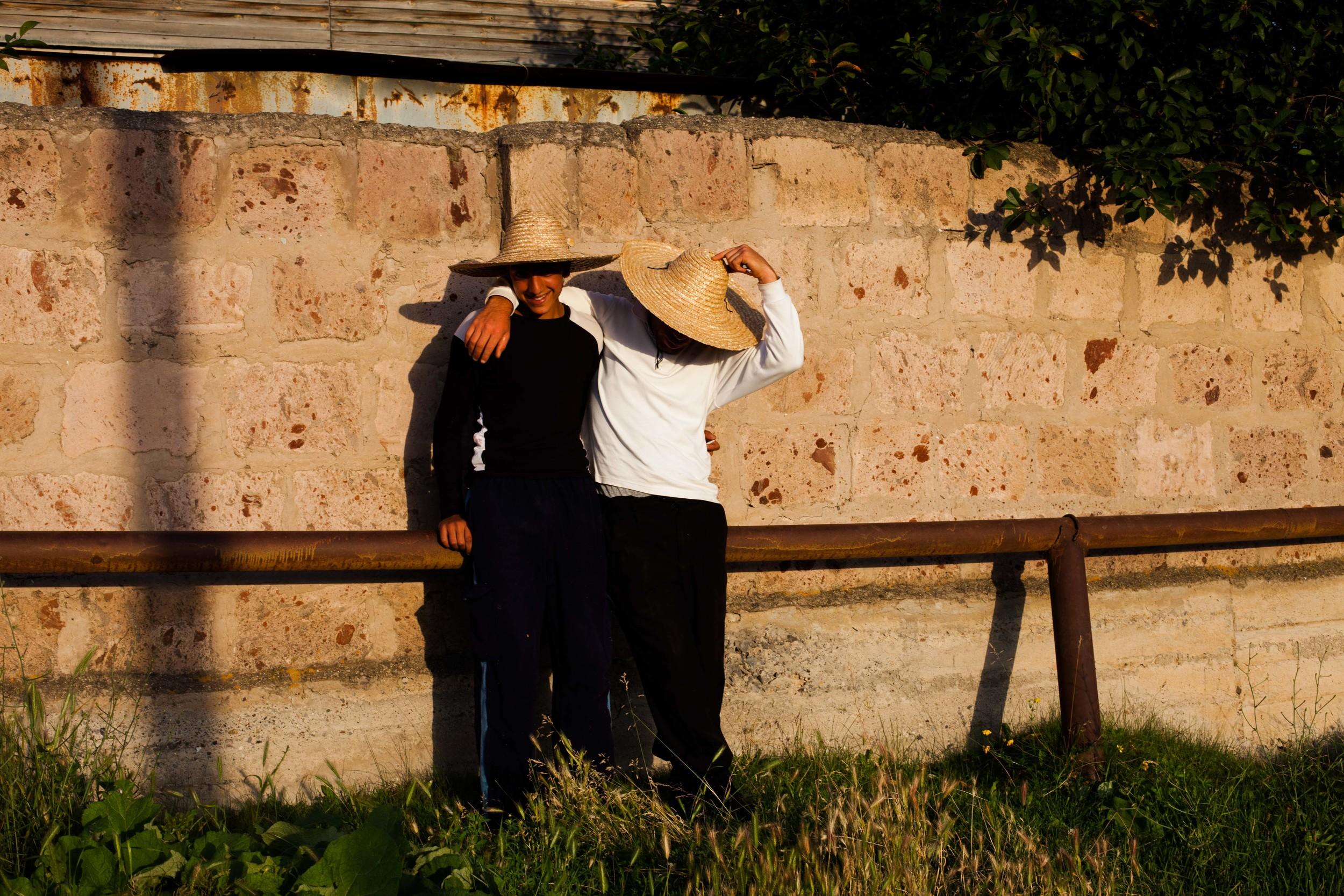 Spitak residents soak in the evening sun.