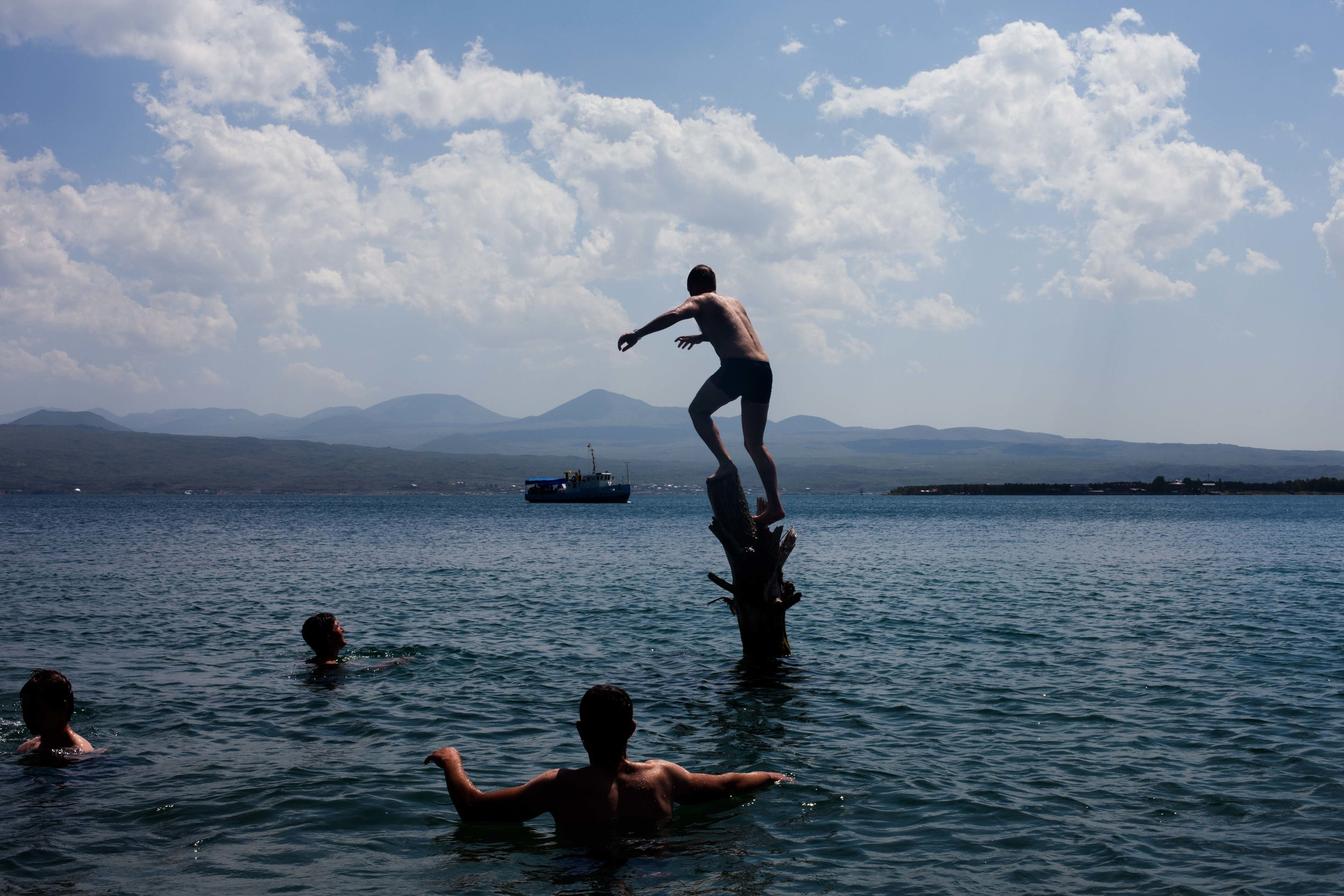 Spitak residents cool off from the summer heat in Lake Sevan. It is one of the largest high-altitude, freshwater lakes in the world and a popular tourist destination.