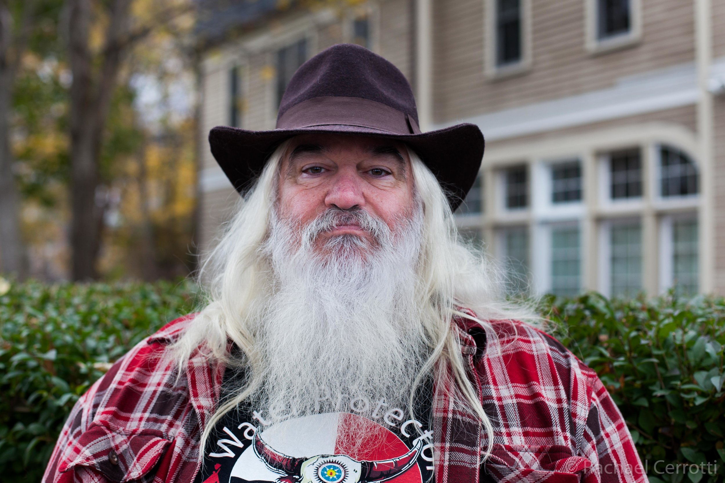 """John Davis, of Holbrook, Massachusetts, has family history in America that dates back to the Pilgrims. For many years he has attended the Day of Mourning as an ally to the many indigenous nations in the Americas. He regularly makes trips out to Pine Ridge Reservation in South Dakota. """"This year I brought all of my grandchildren with me,"""" he said. """"I planted the seed."""""""