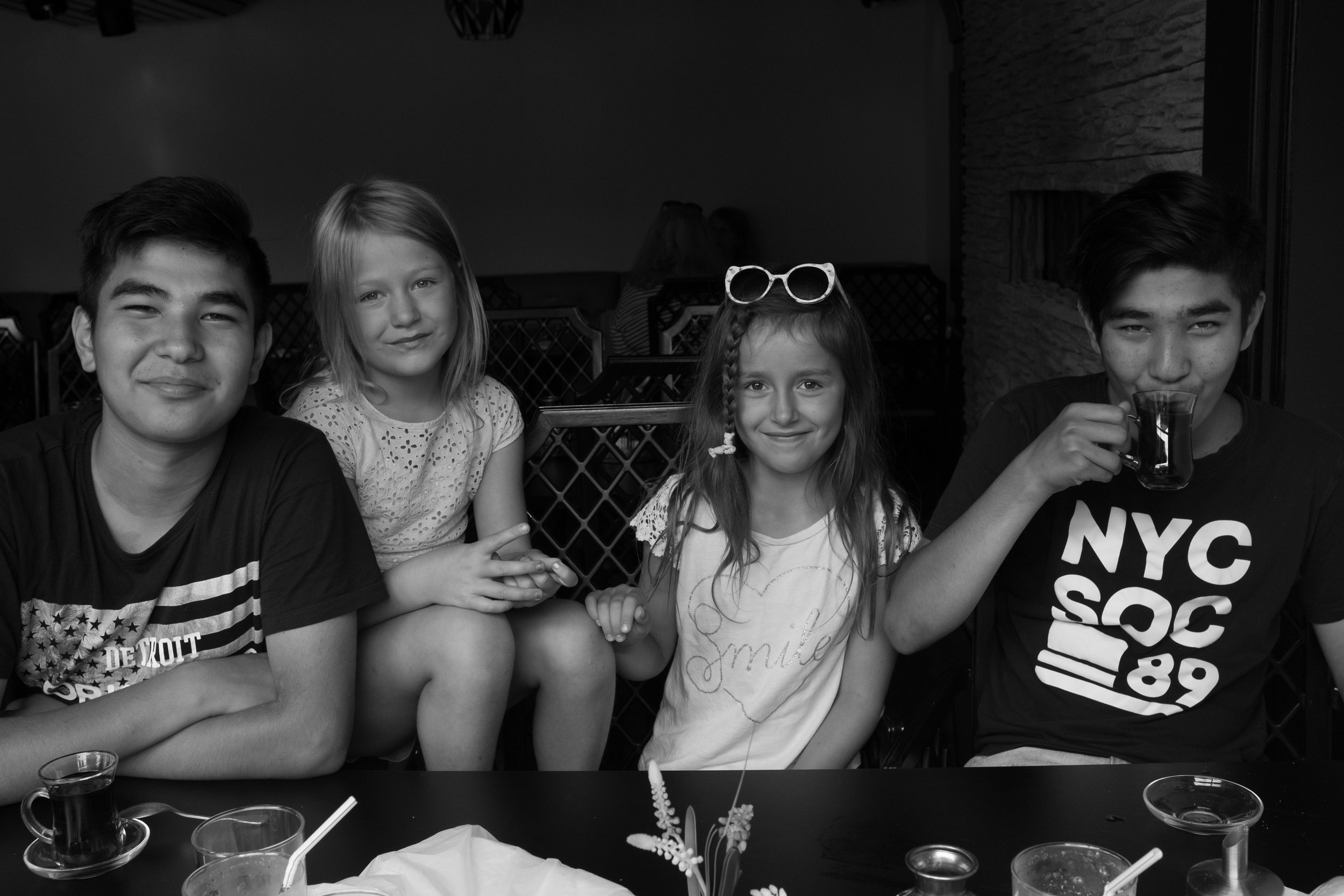Hadi and Mahdi pose for a picture with Annika's grandchildren while out for lunch at an Iranian restaurant in Lund. The young girls admire their new older 'cousins' and love spending time with them.