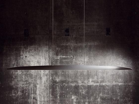 Millelumen Sculpture linear pendant light  in front of concrete