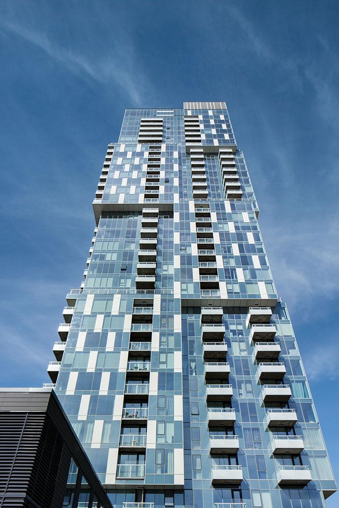 YUL Condominiums   Situé sur le boulevard René-Lévesque, le projet résidentiel YUL favorise une densification typique de centre-ville tout en proposant, avec ses deux tours de 38 étages et ses 17 maisons de ville, une offre diversifiée d'habitations de qualité. Les volumes superposés composant les tours permettent des variations de façades en plus d'une qualité exceptionnelle dans les espaces.  Prix Domus – Projet résidentiel de l'année de plus de 4 étages, APCHQ – région du Montréal métropolitain, 2019  Grand Prix Habitat Design – Choix du Jury et Architecture de paysage, 2013