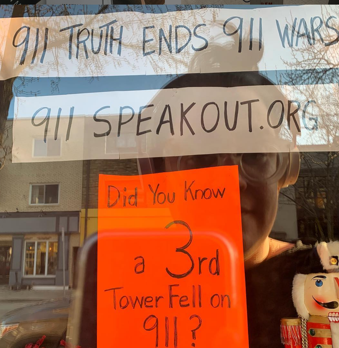 """As a completely unrelated sidenote, I have a neighbor who uses his front window as a 9/11 conspiracy theory display year round but sometimes adds seasonal decor. I've also been leaving him (assuming its a him?) notes for the better part of two years trying to get him to talk to me - conspiracy research is....challenging."" -Stacy Wood"