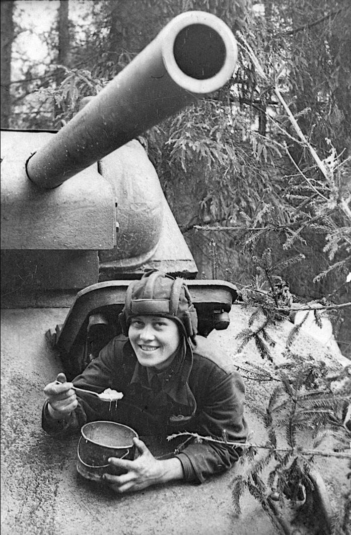 Tanker senior sergeant E.P. Fёdorov eats in his tank, 1942. Source: RGAKFD 0-57505.