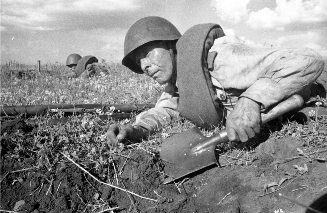 Red Army Soldier entrenching while observing the enemy, Central Front, 1943. Source: RGAKFD 0-312319.