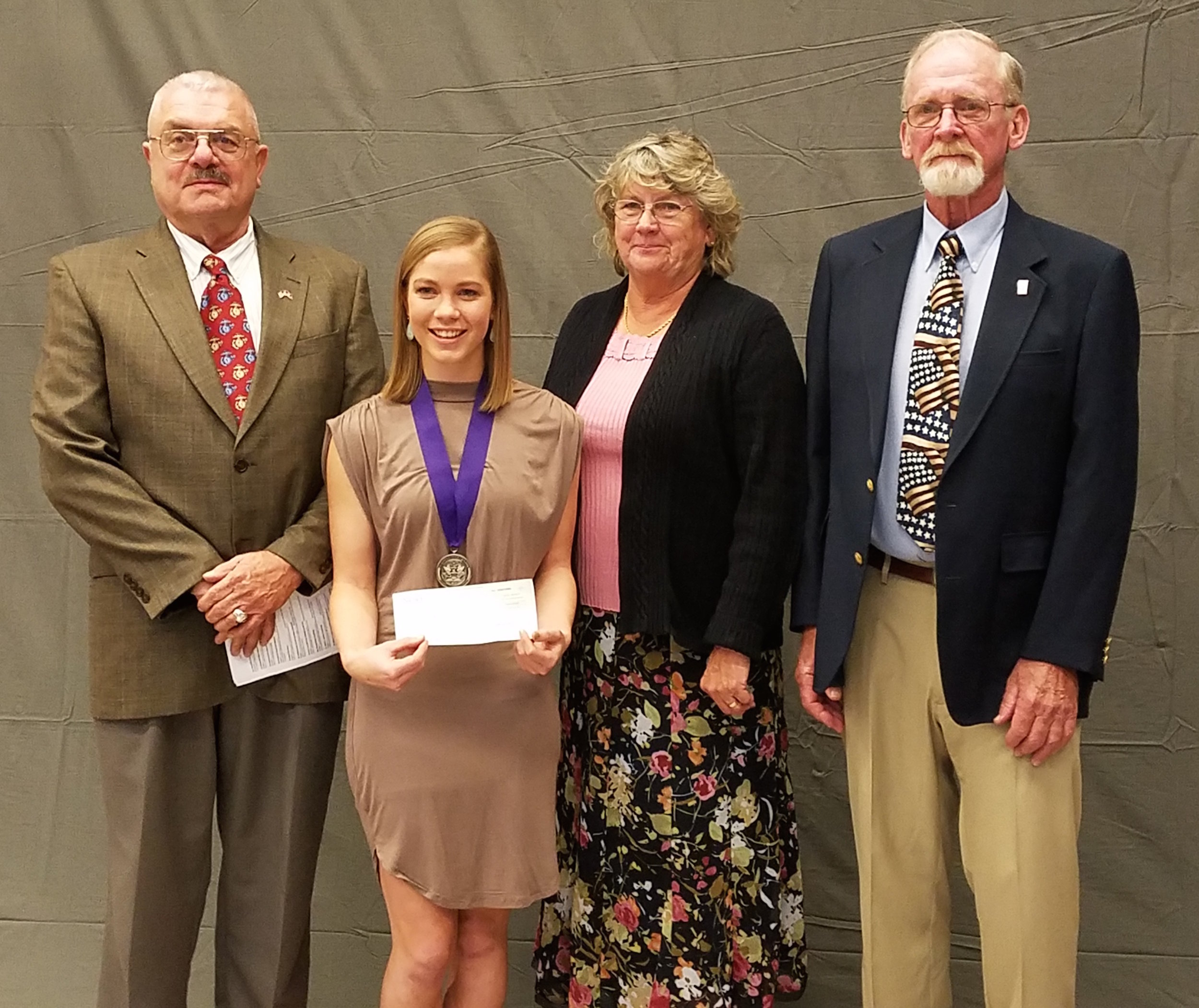 Emma Harvey received the Eric McColley Scholarship of Honor from Gettysburg High School. She is pictured here with Eric's Parents and co-chair of the scholarship, Stan Clark