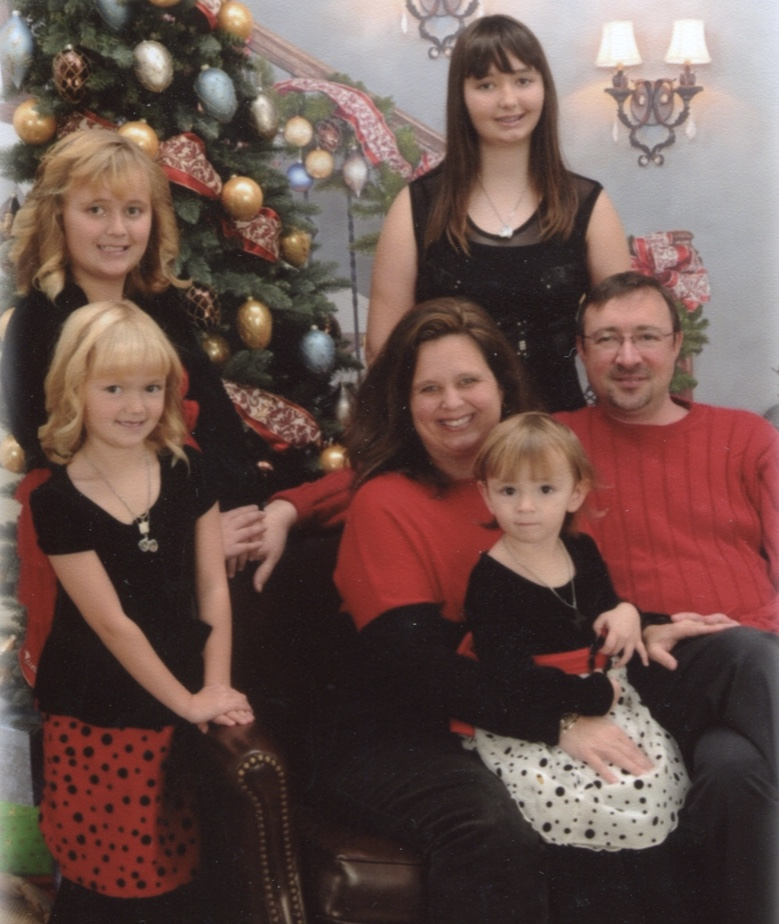 Frank's son, Brian, his wife, Nicol and granddaughters Meredith, Kristina, Catherine, and Madelyn.