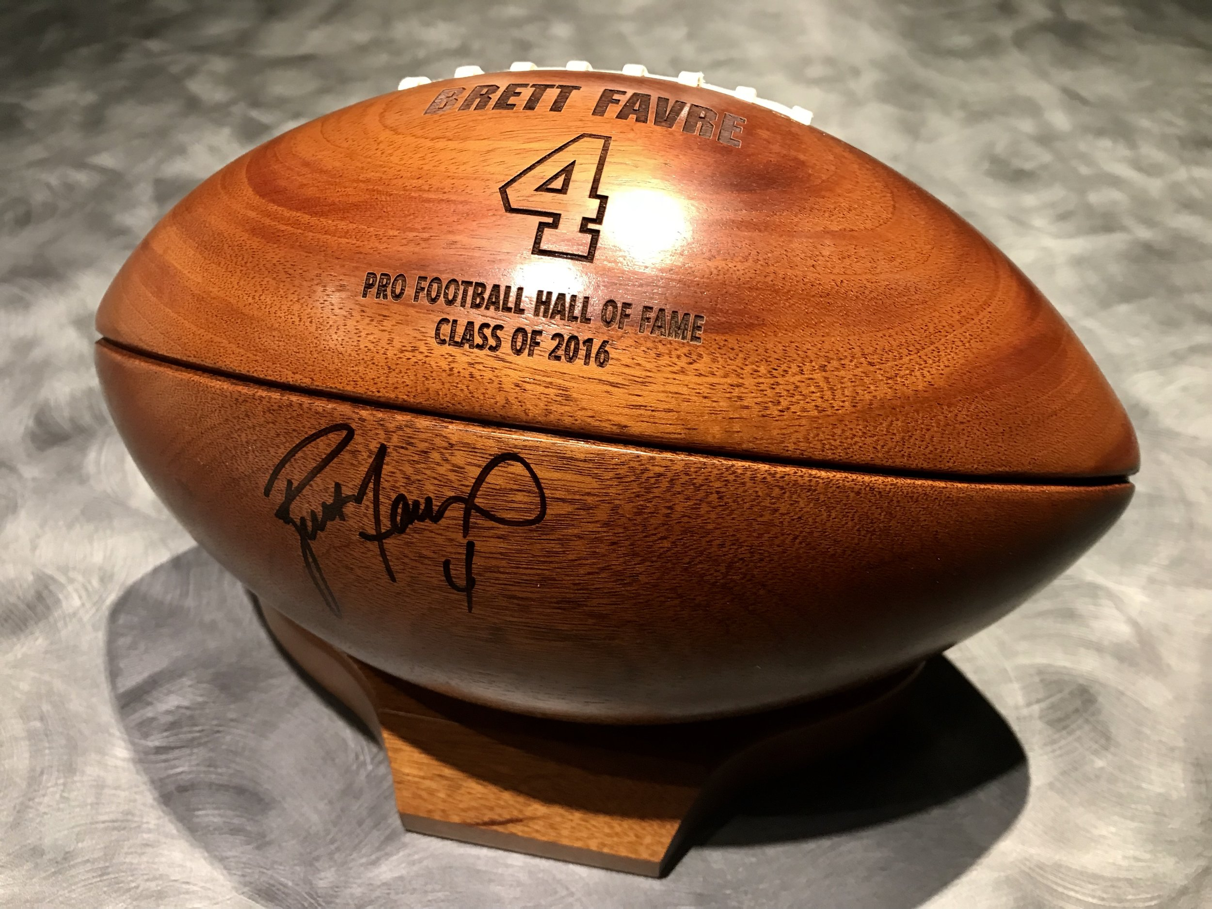 Unique wooden football signed by Brett Favre
