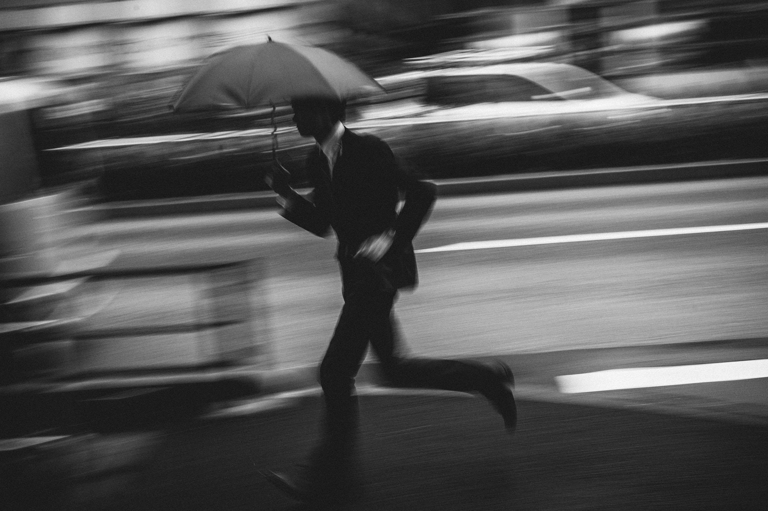 man running rain.jpg