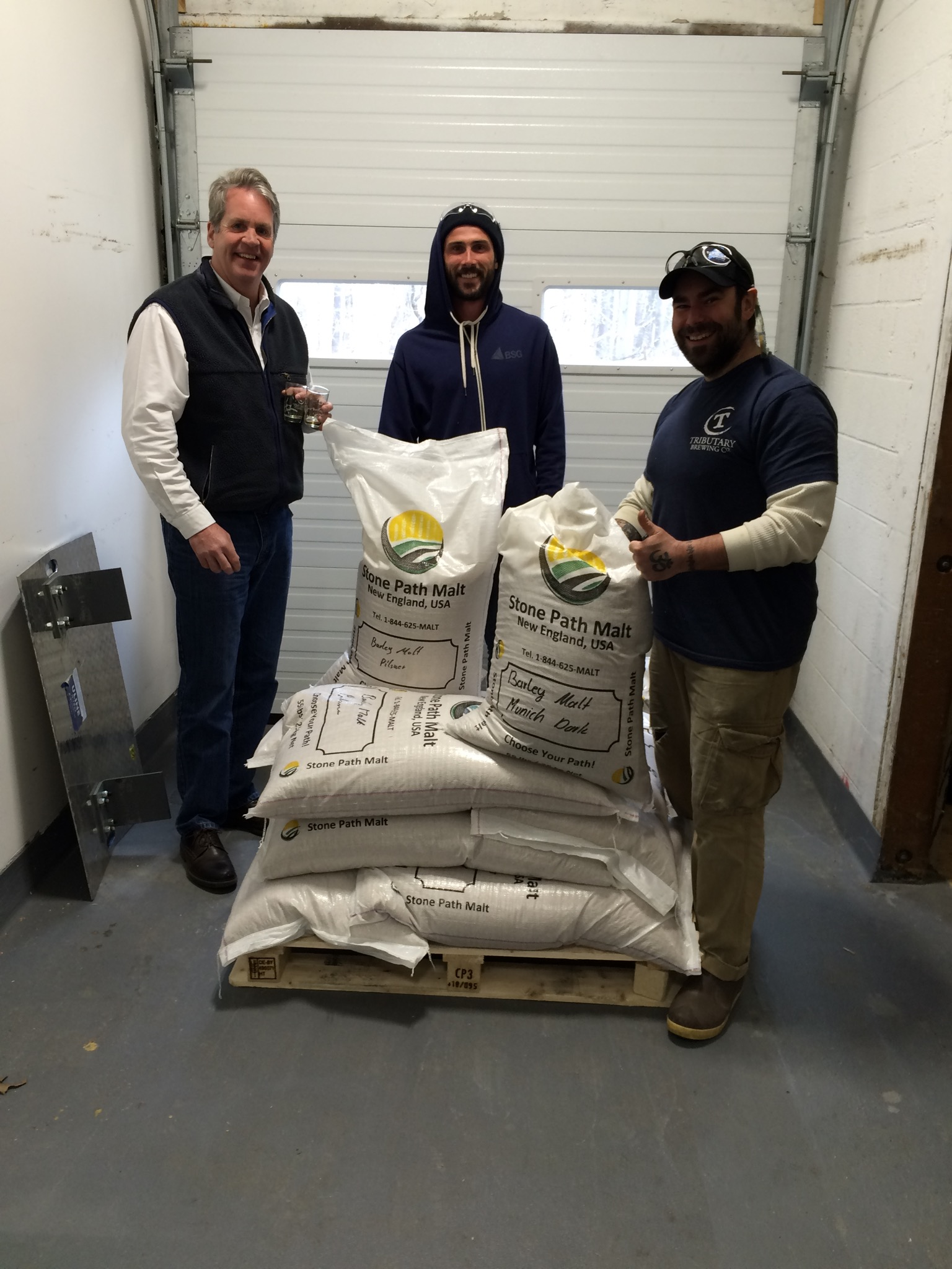 Mark making a delivery to Ian and Jeff Goodno at Tributary Brewing Company. Tod Mott and Mike were off sampling!
