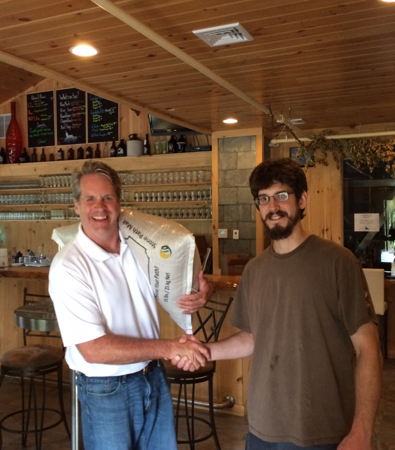 Eric Berzins, Head Brewer, Fort Hill Brewery takes his first delivery from Stone Path Malt!