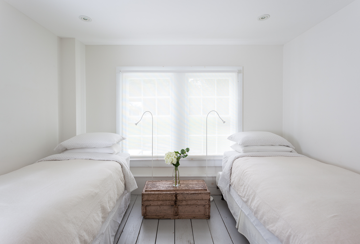 Two twin beds sleep one guest each at the Floating Farmhouse Catskills vacation rental in upstate New York, 2 hours from NYC