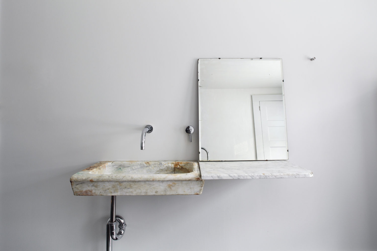 Guest bath ancient Italian marble sink in the Floating Farmhouse Catskills vacation rental in upstate New York.