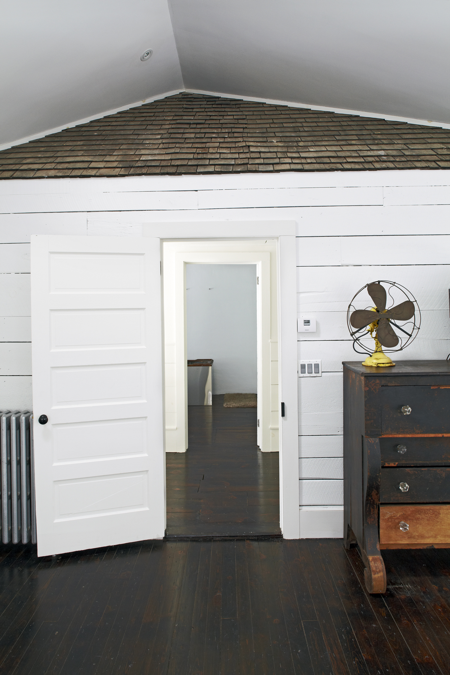 Master bedroom original cedar roof shingles in the Floating Farmhouse Catskills vacation rental in upstate New York.