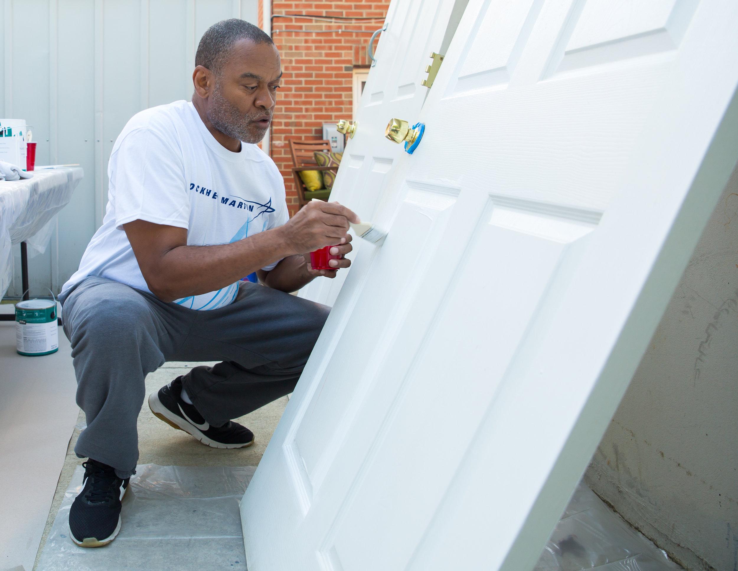 Veterans-Closeup-of-Man-Painting-Door-Lockheed-Bethesda.jpg