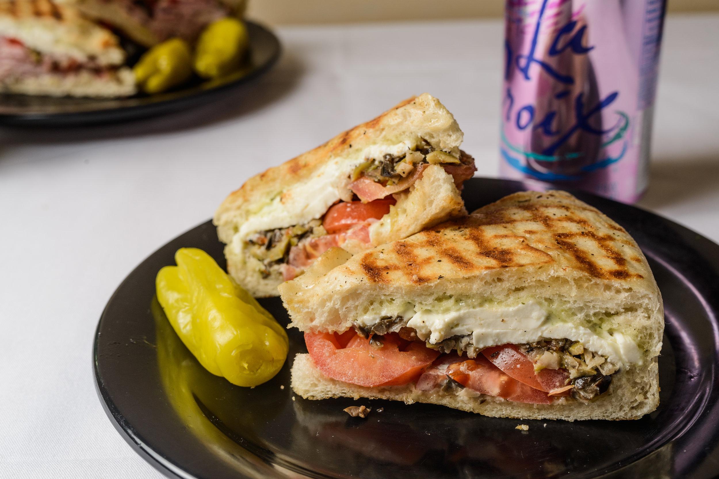 #7 - $7.00 - The Veggie – Roma tomatoes, fresh mozzarella, olive salad and pesto mayo