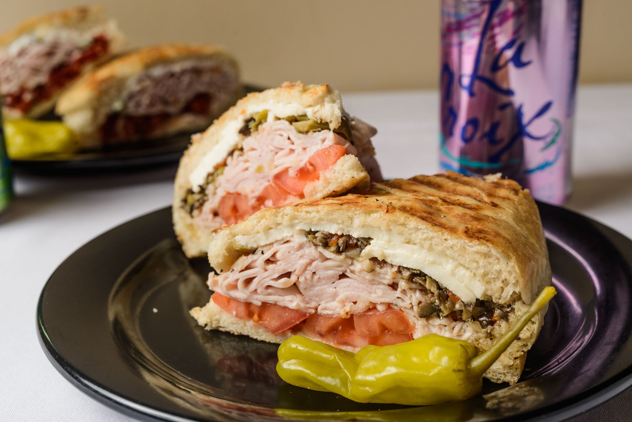 #4 - $8.50 - The Slam – Ham, salami, fresh mozzarella, roasted red bell peppers, pesto mayo and olive salad