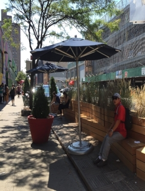 A parklet in front of Essex Street Market in New York City.