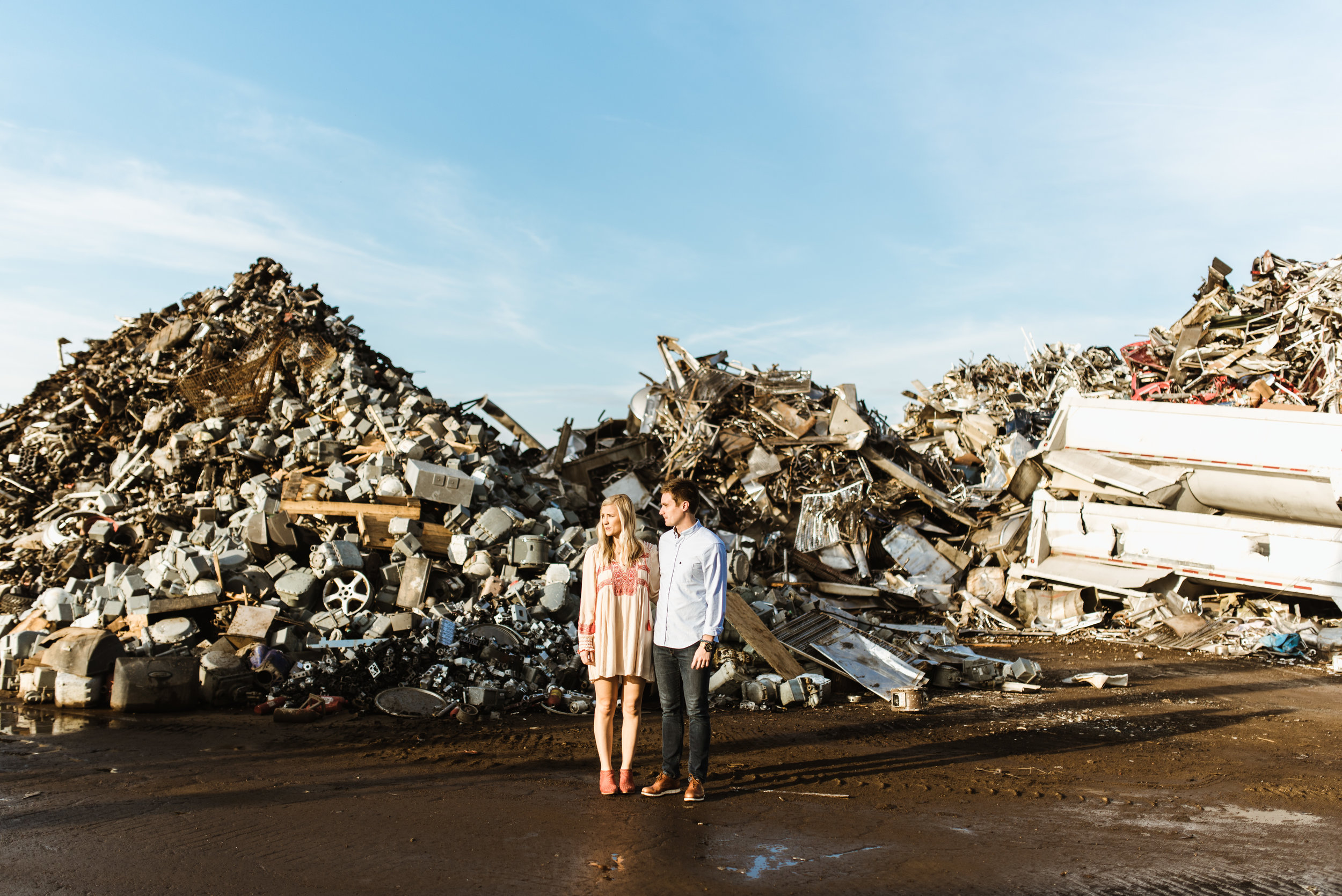 For this session, I had Mandy and Kevin meet me in a scrapyard at sunrise. Here's juxtaposition at work again. She's a nice dress and amazing shoes while Keven sports a contrasting button up, fitted jeans and nice shoes.
