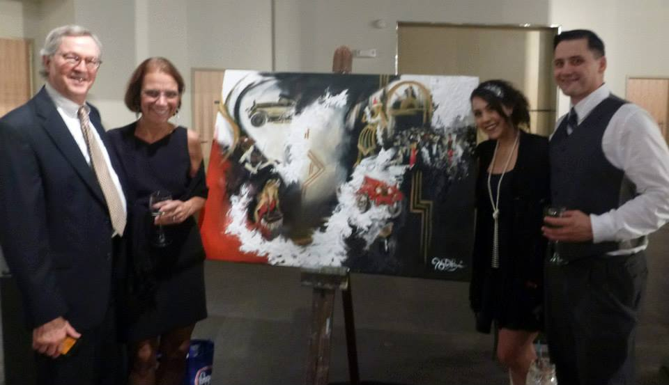 This is what the live event painting looked like at the end of the night, after just a few hours of painting. Here we are standing next to it with the winning bidders just after the live auction