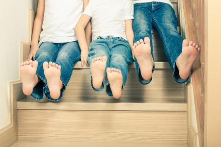 40952190_S_feet_children_stairs_jeans_excited_sitting_boy_girl_kids.jpg