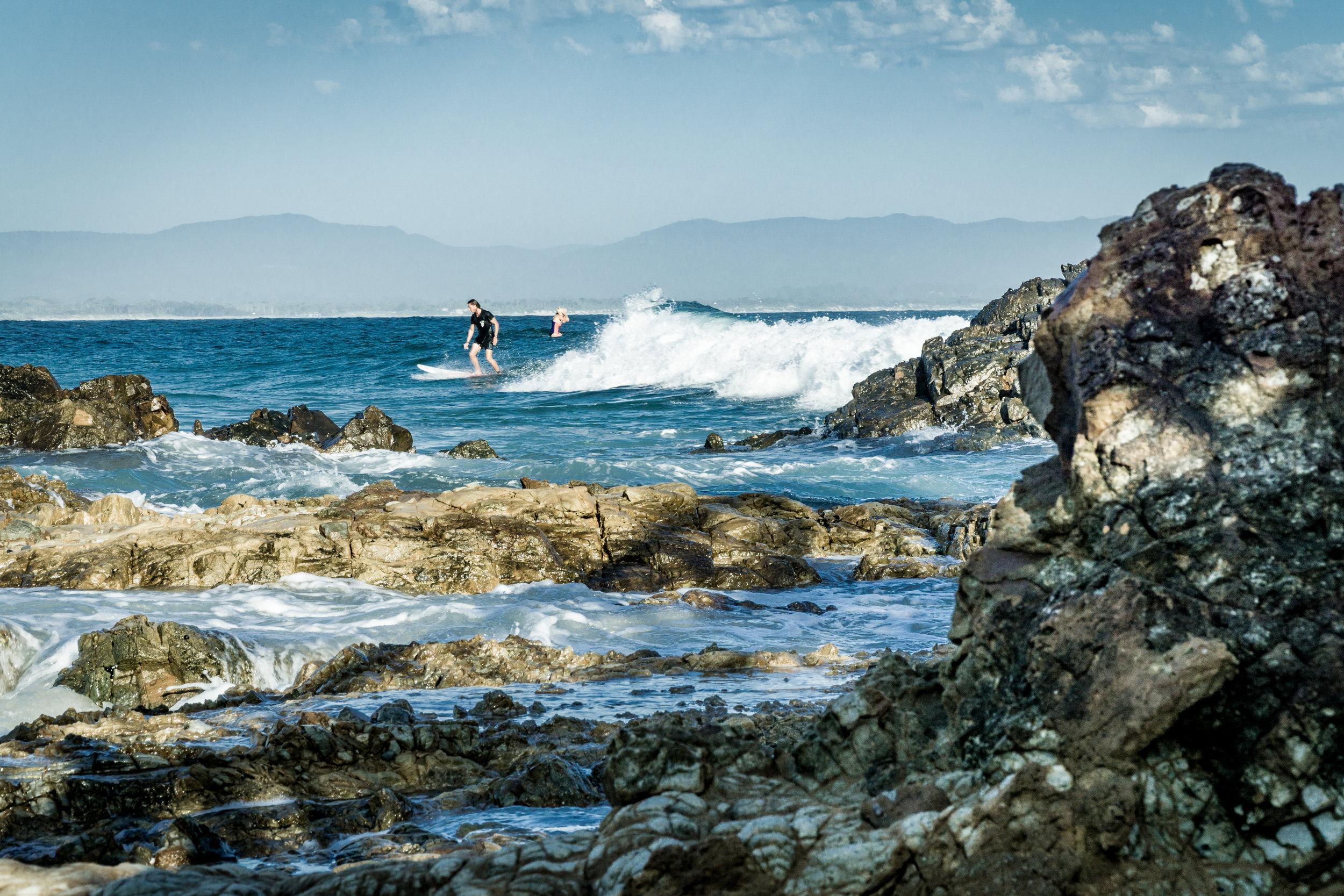 Byron Bay early morning surfers near Fisherman's Lookout