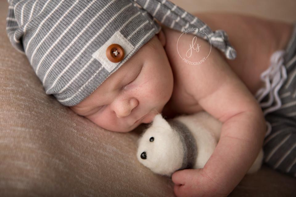 newborn baby boy with small polar bear