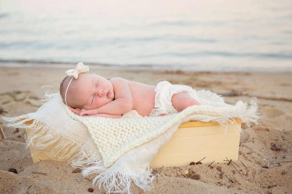 outdoor newborn session with baby in boat