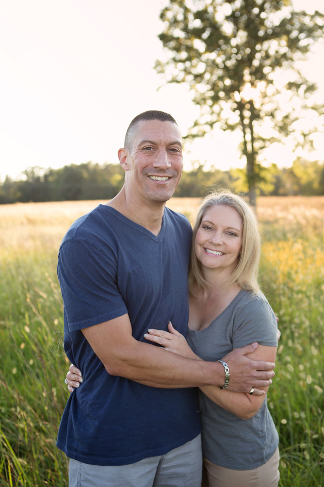 husband and wife portrait in a field at Battlefield Manasses