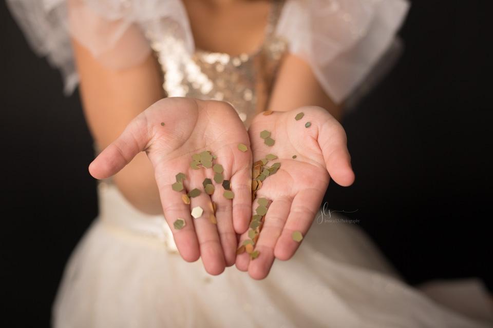 gold glitter on girl's hands