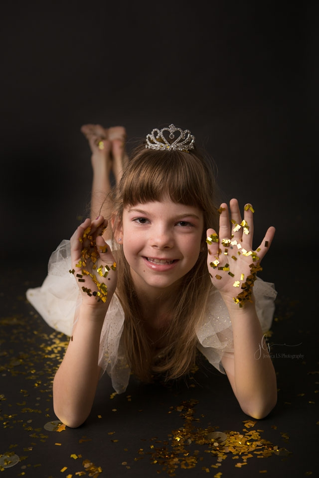 7 year old girl showing gold glitter on her hands