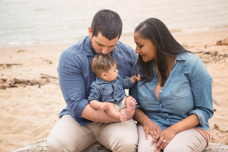 Family session on the beach in blue and tan