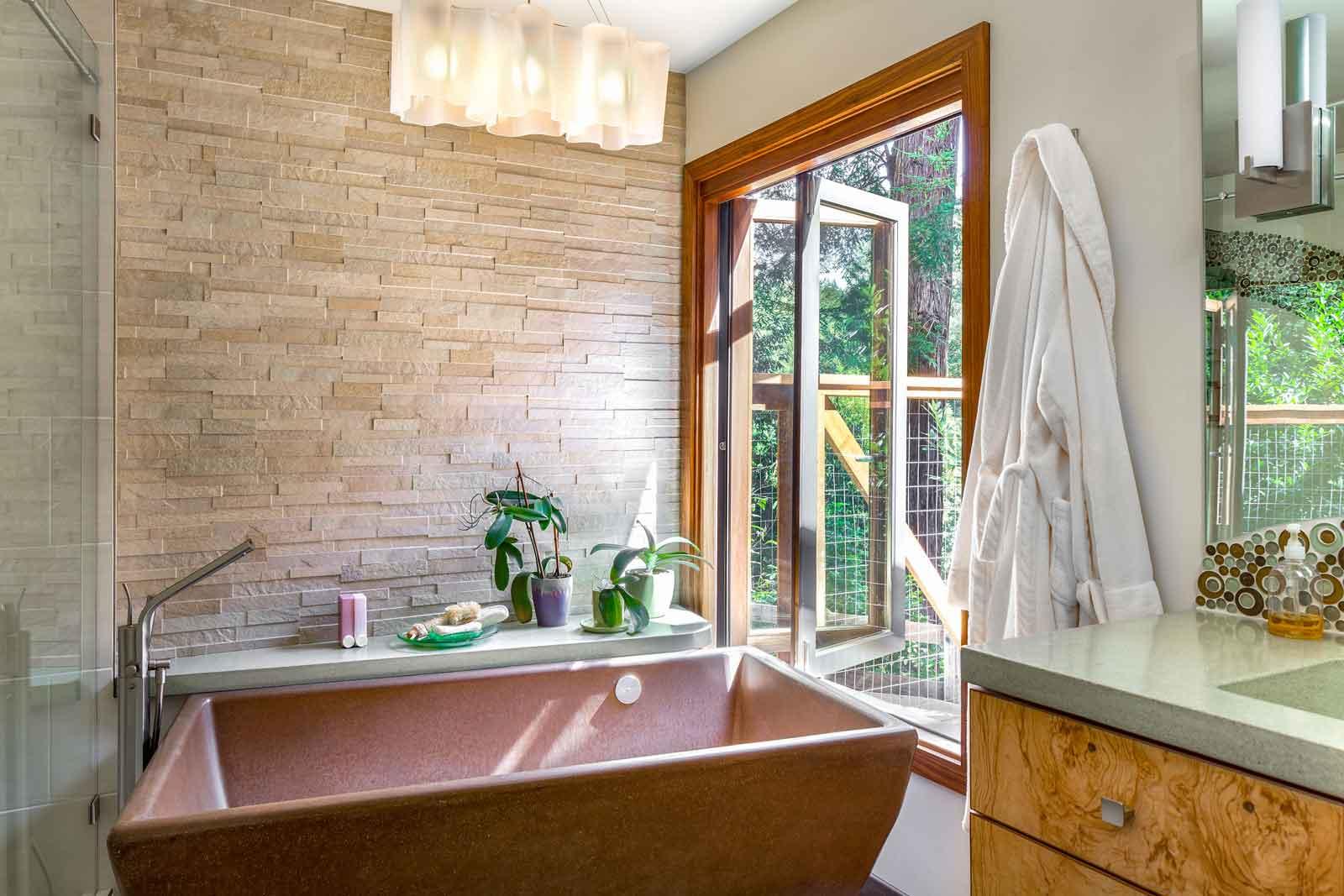 Kobe walnut wood folding window from concrete freestanding tub