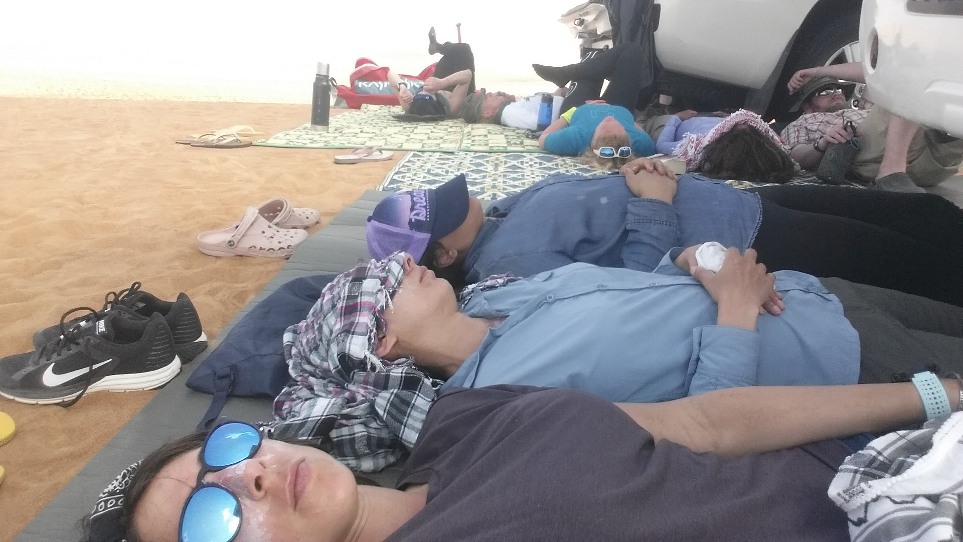 Not the scene of some horrific traffic accident but the team's siesta in the shade of the support vehicles.