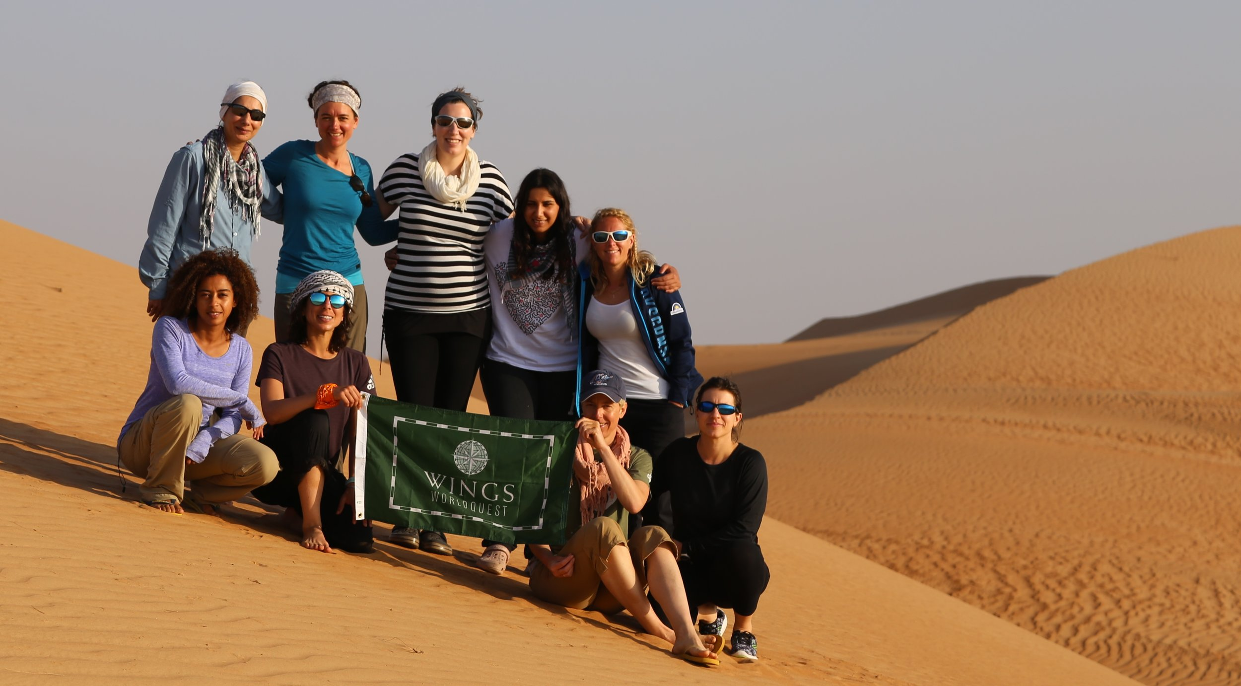 The Euro-Arabian North Pole Expedition Team and flag carriers #23: Misba (UK), Susan (France), Felicity (Expedition Leader), Mariam (Saudi Arabia), Ida (Sweden), Steph (Cyprus), Natasa (Slovenia), Lamees (Kuwait) and Anisa (Oman).