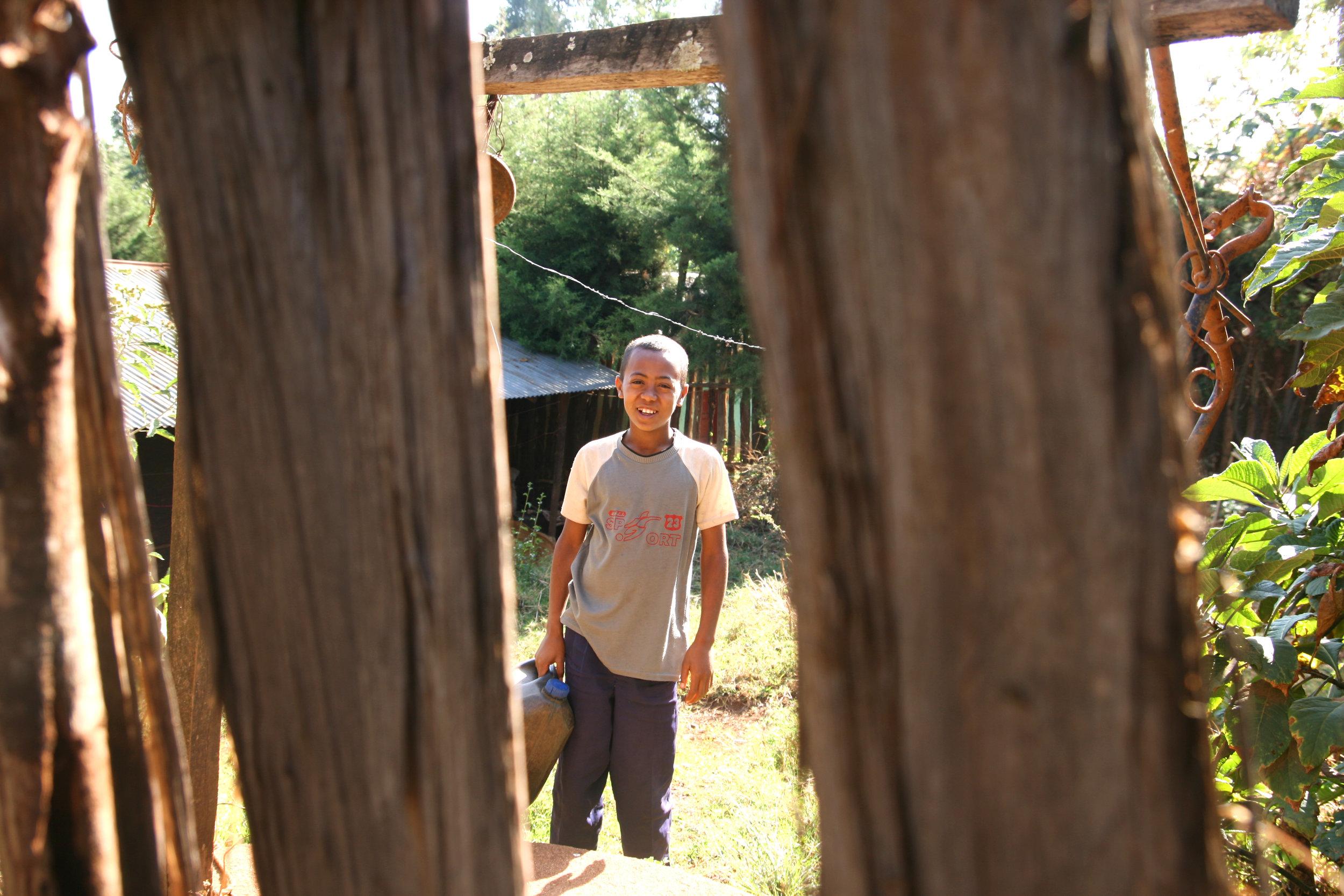 Abiyu Through Fence.jpg