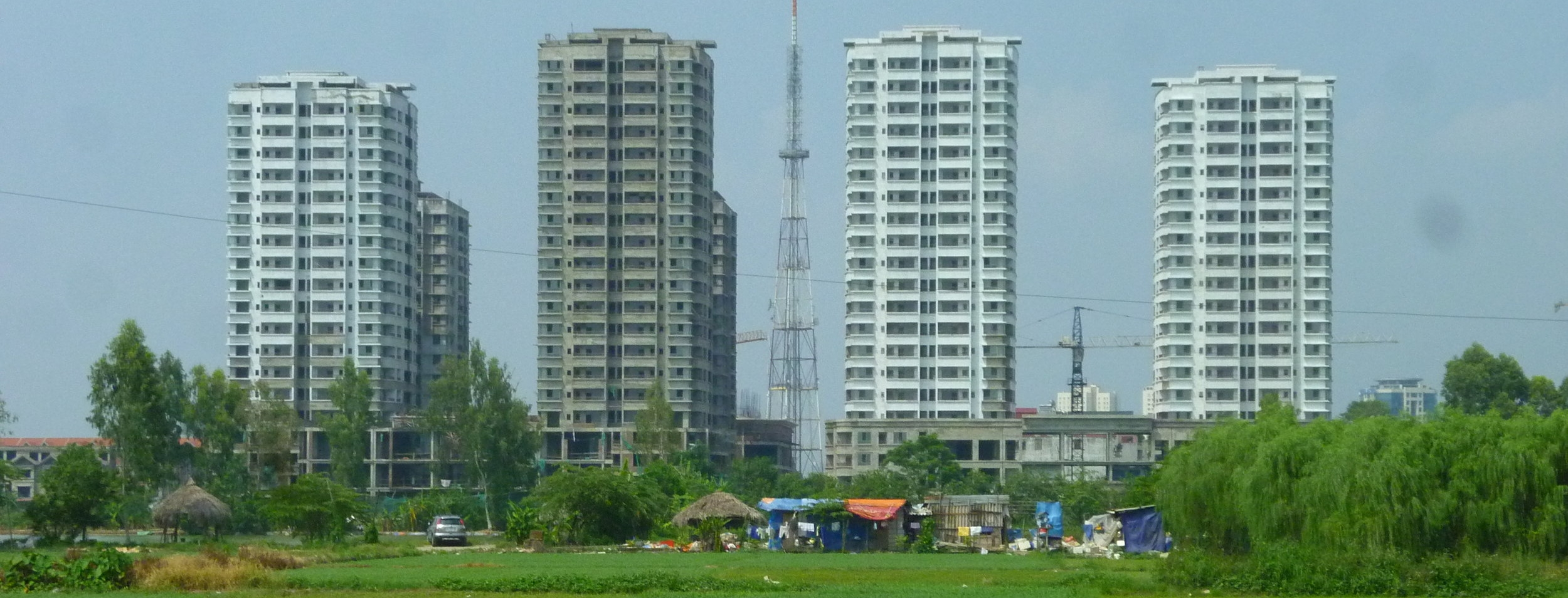 A new mixed-use development rises from the paddy fields on the periphery of Hanoi. Photo by Clément Musil (2012).
