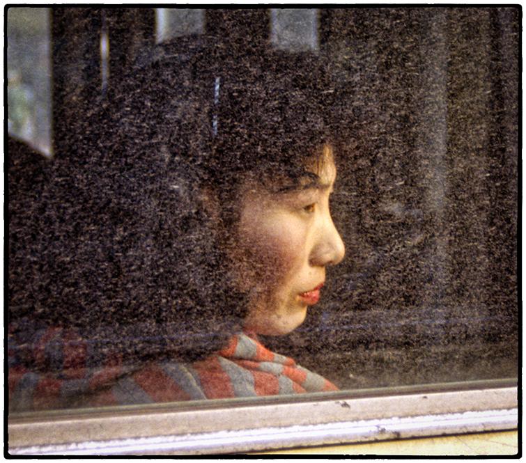 Woman on bus, China