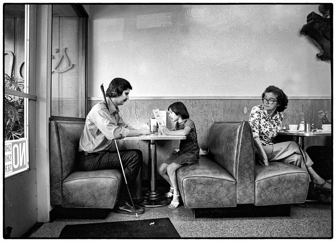 Blind Man's Daughter Reading a Menu, Santa Rosa, 1976