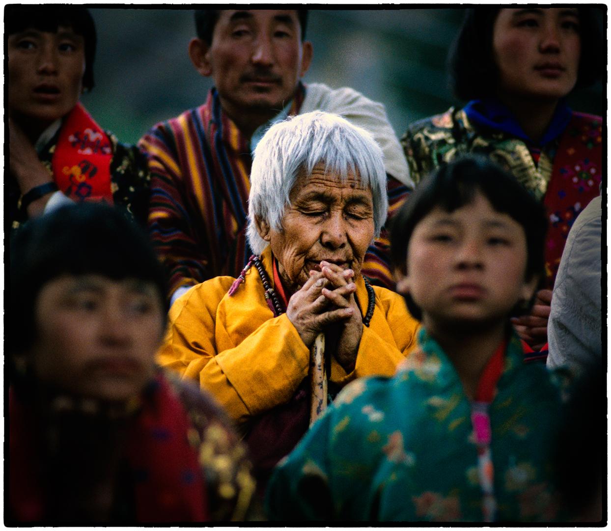 Woman in Prayer, Paro, Bhutan