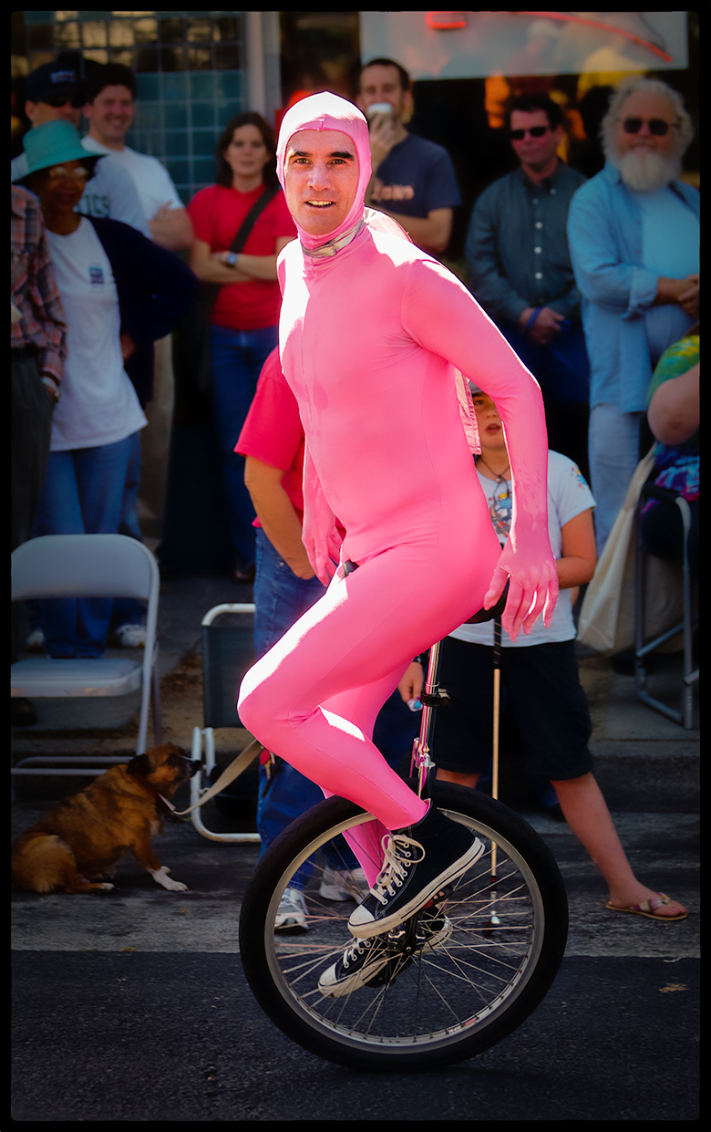 """Unicyclist, """"How Berkeley Can You Be"""" Parade, 2006"""