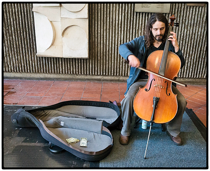 A cellist outside the Mission St. station