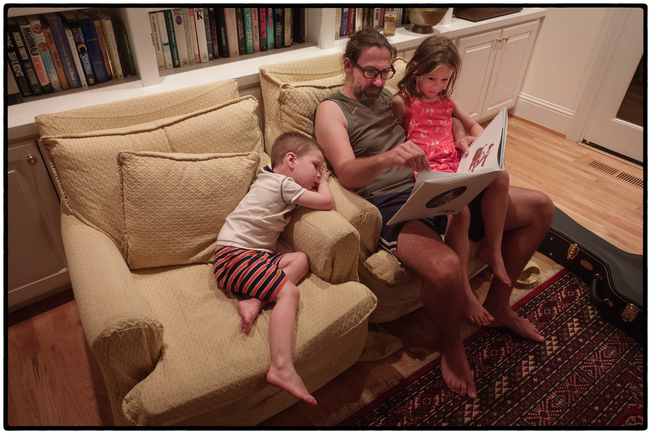 Andrew reading to Kennedy and Isla