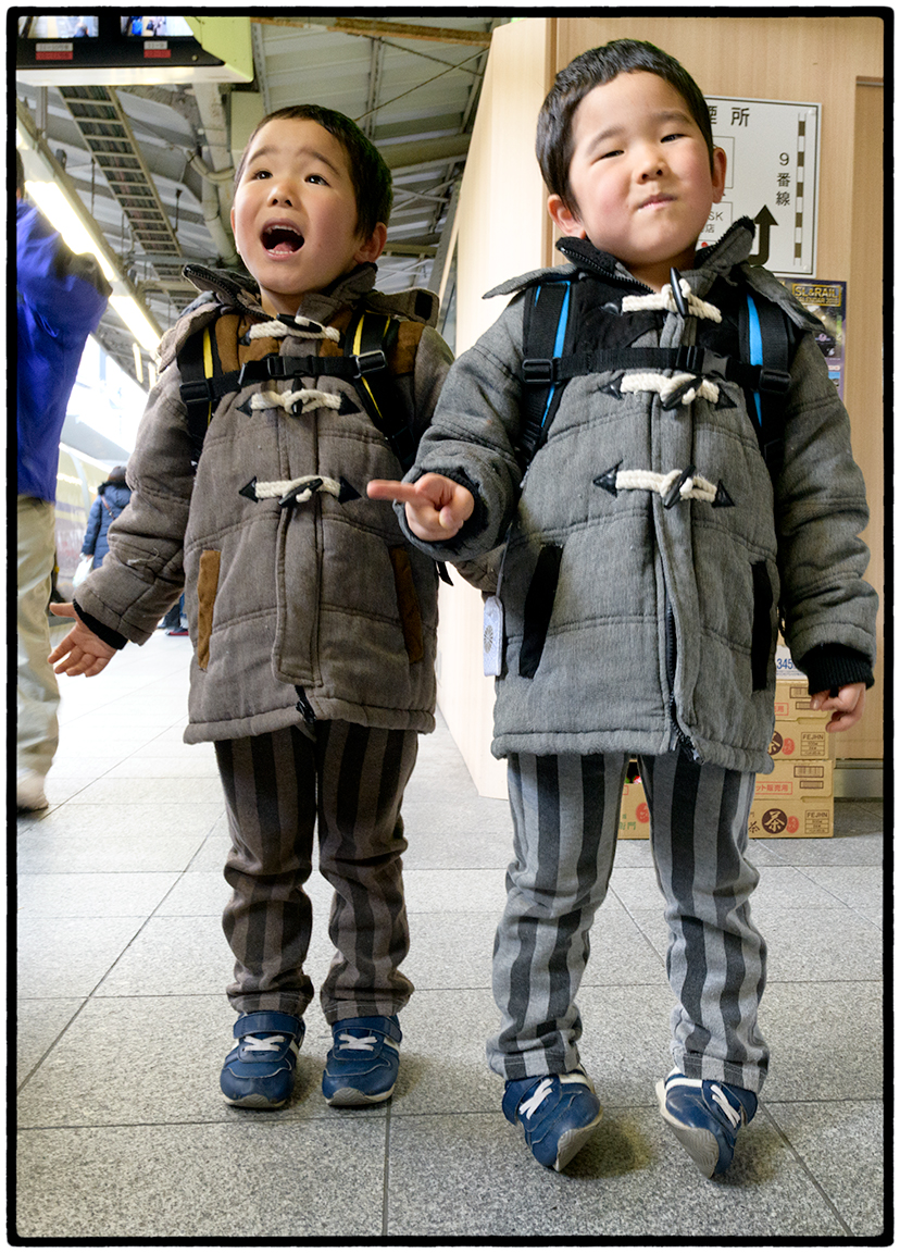Twins stepping off a Train, Tokyo