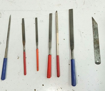 Some of the tools used in hand-filing the pins.